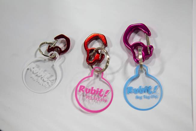 Rubit! pet tag clips are displayed during SuperZoo, a trade show for the pet industry, at the Mandalay Bay Convention Center Tuesday, Sept. 11, 2012. The carabiner-style clips let pet owners easily remove and change their pet's ID tags.