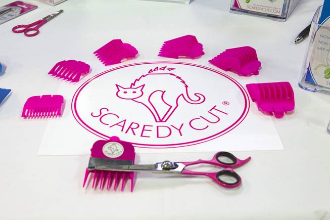 A Scaredy Cut home pet grooming kit is displayed during SuperZoo, a trade show for the pet industry, at the Mandalay Bay Convention Center Tuesday, Sept. 11, 2012. Scissors are adapted to use hair clipper's attachment guide combs for pets that are bothered by the noise or vibration of electric clippers.