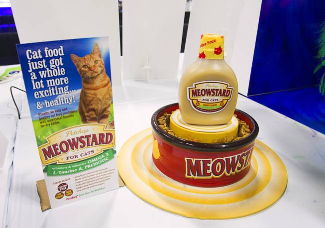 Meowstard cat condiment is displayed during SuperZoo, a trade show for the pet industry, at the Mandalay Bay Convention Center Tuesday, Sept. 11, 2012. The dietary supplement adds vitamins, minerals, L-Taurine and prebiotic to a cat's dry food.