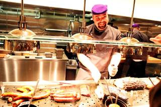 Tony Pettingill mans the carving station at Bacchanal Buffet in Caesars Palace on Tuesday, Sept. 11, 2012.