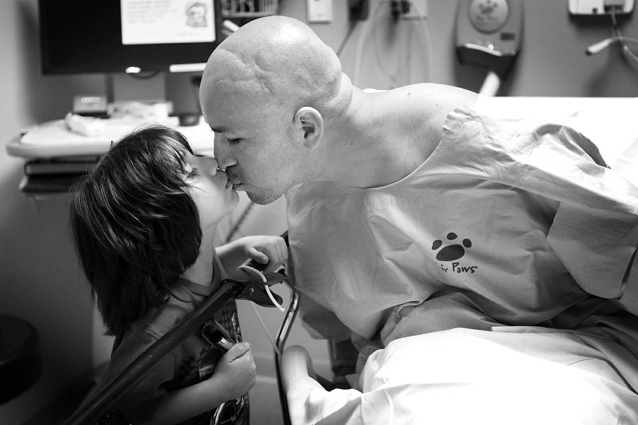 Arturo Martinez-Sanchez kisses his son, Alejandro, 5, before going in for surgery to repair his skull Sept. 12, 2012 at Valley Hospital in Las Vegas.