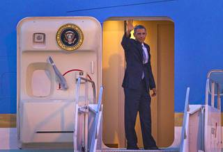 President Barack Obama waves as he boards Air Force One to depart McCarran International Airport Wednesday, Sept. 12, 2012.  Obama rallied supporters during a campaign stop at the Cashman Center.