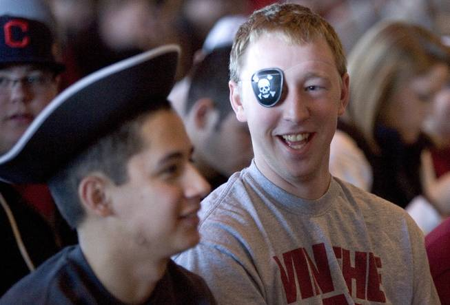 Washington State students Jeff Honnold, center, and his friend, Shane Porcincula, left, wear pirate costumes to the introductory press conference for football coach Mike Leach, on Tuesday, Dec. 6, 2011, in Pullman, Wash.