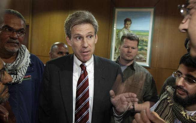 U.S. envoy Chris Stevens speaks to local media at the Tibesty Hotel, where an African Union delegation was meeting with opposition leaders in Benghazi, Libya, on April 11, 2011. Libyan officials say the U.S. ambassador and three other Americans were killed in an attack on the U.S. consulate in the eastern city of Benghazi.