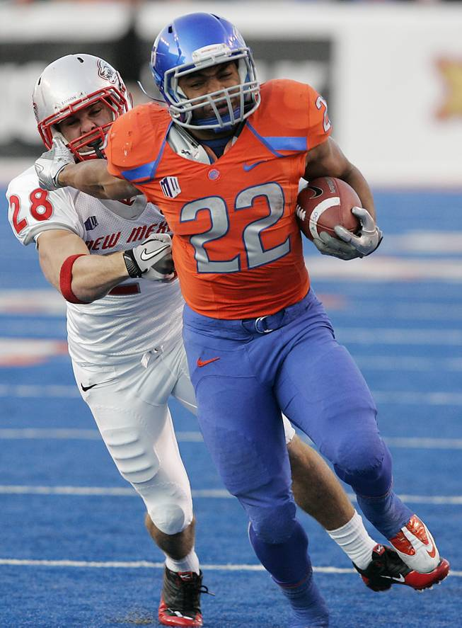 In this Dec. 3, 2011, file photo, Boise State running back Doug Martin (22) rushes past New Mexico's Bubba Forrest (28) during the first half of an NCAA college football game in Boise, Idaho.
