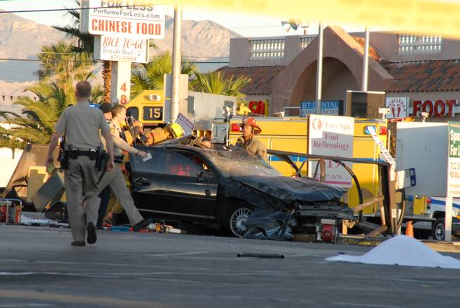 Metro Police investigate after a car crashed into a bus stop on Spring Mountain Road east of Decatur Boulevard, killing four people, on Thursday, Sept. 13, 2012.