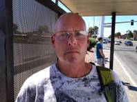 Greg King waits for the bus on Flamingo Road near Decatur on Thursday, Sept 13, 2012, the same day that a car crashed into a bus stop, killing four and injuring eight others.
