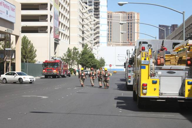 Firefighters are on the scene at Audrie Lane behind Planet Hollywood after reports of a fire at the hotel came in on Thursday, Sept. 13, 2012.