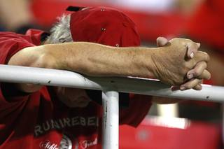 A UNLV fan hangs his head late in the fourth quarter of their game against Washington State Friday, Sept. 14, 2012 at Sam Boyd Stadium. Washington State won the game 35-27, dropping UNLV to 0-3 on the season.