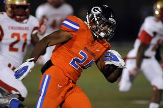 Gaels halfback Nathan Starks returns a kickoff for a touchdown during the first quarter against visiting Bergen Catholic High School at Bishop Gorman High School on Friday night.