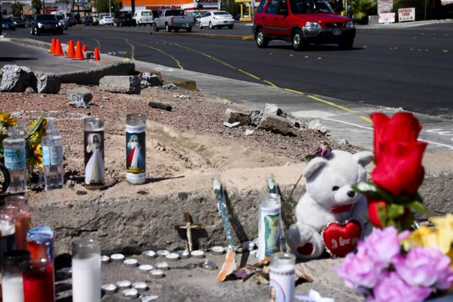 Track markers detailing the trajectory course of the car involved in the bus stop crash are seen in the background of the memorial site of the accident Friday, Sept. 14, 2012.