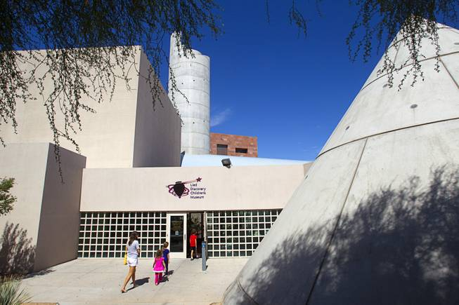A family heads into the Lied Discovery Children's Museum, part of the Cultural Corridor, in downtown Las Vegas Sunday, Sept. 16, 2012.