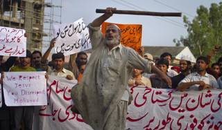 A Pakistani worker shouts anti U.S. slogans during a rally in Islamabad, Pakistan on Saturday, Sept. 15, 2012 as part of widespread anger across the Muslim world about a film ridiculing Islam's Prophet Muhammad. The banner at bottom reads,