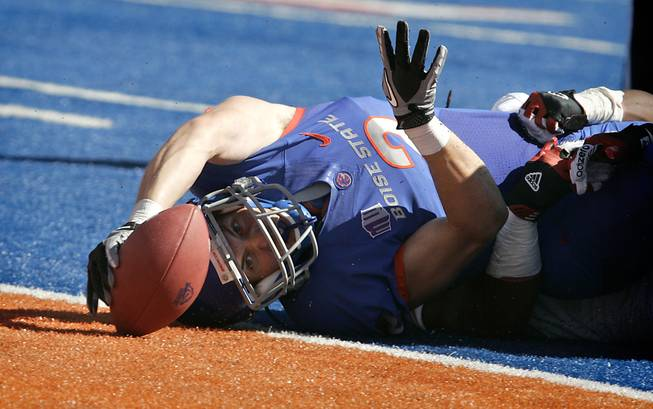 Boise State's Matt Miller stretches for a touchdown against Miami of Ohio during the first half of the Broncos' victory on Saturday, Sept. 15, 2012, in Boise, Idaho.