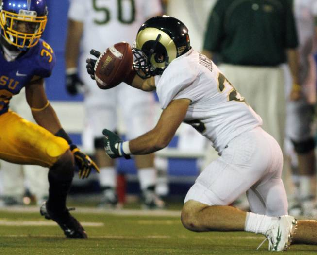 Colorado State's Joe Hansley (right) fumbles the ball as Cullen Newsome recovers it during San Jose State's 40-20 victory on Saturday, Sept. 15, 2012, in San Jose, Calif.