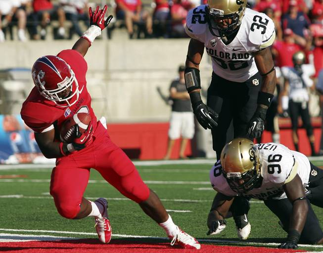 Fresno State's Robbie Rouse falls into the end zone for one of his four rushing touchdowns against Colorado in the Bulldogs' 69-14 victory on Saturday, Sept. 15, 2012, in Fresno, Calif.