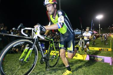 Timothy Johnson runs over an obstacle during the CrossVegas cyclocross race Wednesday, Sept. 19, 2012 at Desert Breeze Park.