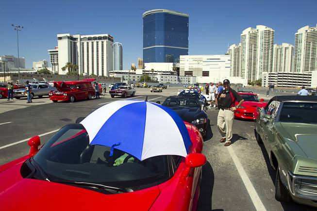 An umbrella keeps sun off the drivers seat of a Dodge Viper before a classic car parade on the Las Vegas Strip Wednesday, Sept. 19, 2012. The annual parade serves as a kick-off to the Barrett-Jackson Las Vegas auto auction at the Mandalay Bay. The auction runs Thursday through Saturday.