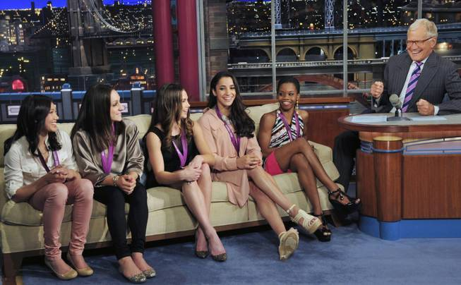"From left, Kyla Ross, Jordyn Wieber, McKayla Maroney, Aly Raisman and Gabby Douglas, members of the U.S. women's Olympic gymnastics gold medal-winning team, join TV show host David Letterman on the set of ""The Late Show With David Letterman"" in New York on Tuesday, Aug. 14, 2012."