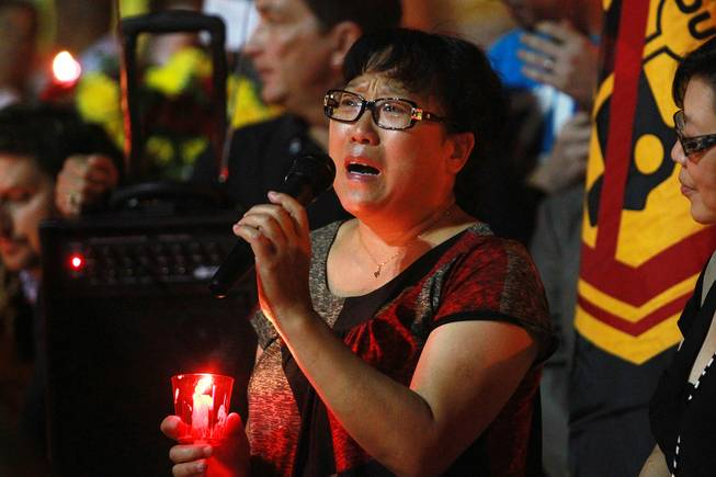 Yao Jia Zhen talks about her nephew Zexiang Wang during a candle light vigil Thursday, Sept. 20, 2012 for people who were killed and injured when Gary Lee Hosey Jr. drove into a bus stop a week earlier. Wang, a 19-year-old student from China, is still paralyzed and in critical condition.