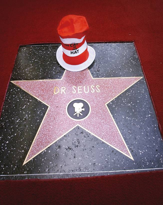 The hat worn by The Cat in the Hat, a creation of famed children's book author Theodor Seuss Geisel, better known as Dr. Seuss, adorns Dr. Seuss' posthumous star on the Hollywood Walk of Fame in Los Angeles' Hollywood district after dedicaton ceremonies Thursday, March 11, 2004.
