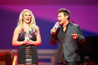 Britney Spears and Ryan Seacrest introduce a musical group during the 2012 iHeart Radio Music Festival at MGM Grand Garden Arena on Friday, Sept. 21, 2012.