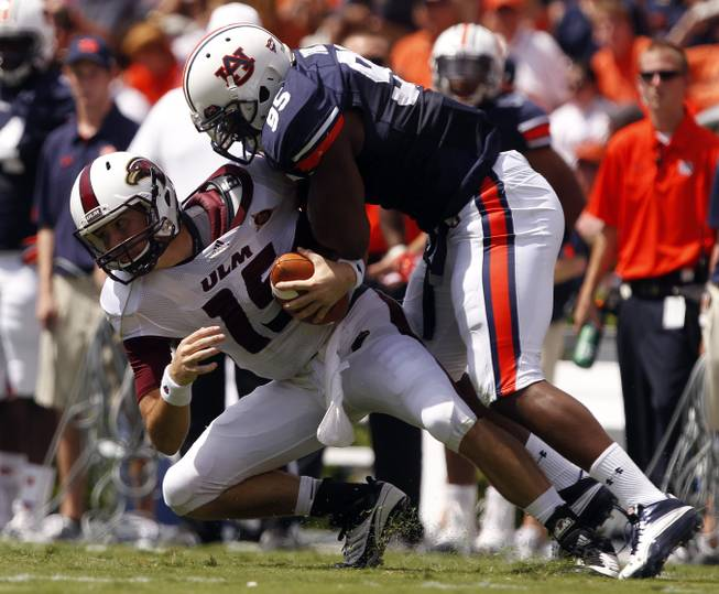 Auburn defensive end Dee Ford (95) sacks Louisiana-Monroe quarterback Kolton Browning (15) during the first half of an NCAA college football game on Saturday, Sept. 15, 2012, in Auburn, Ala.
