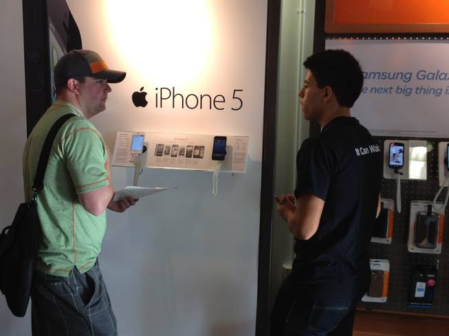 About 50 people lined up outside the AT&T store in Summerlin at 920 S. Rampart Blvd. shortly before 8 a.m. Friday, Sept. 21, 2012, to buy the new iPhone 5.