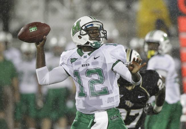 This Oct. 8, 2011 file photo shows Marshall quarterback Rakeem Cato (12) looking for a receiver during the first half of an NCAA college football game against Central Florida, in Orlando, Fla.