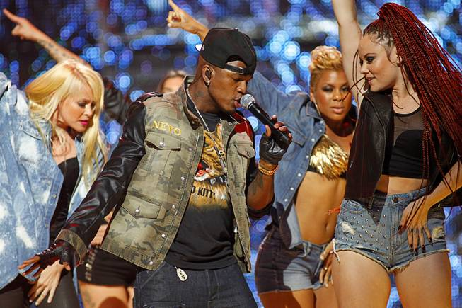 Ne-Yo (C) performs with dancers during second day of the 2012 iHeartRadio Music Festival at the MGM Grand Garden Arena in Las Vegas, Nevada September 22, 2012.
