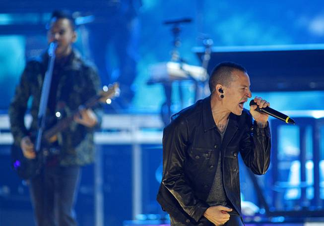 Chester Bennington, right, of Linkin Park performs during the second day of the 2012 iHeartRadio Music Festival at MGM Grand Garden Arena on Saturday, Sept. 22, 2012.