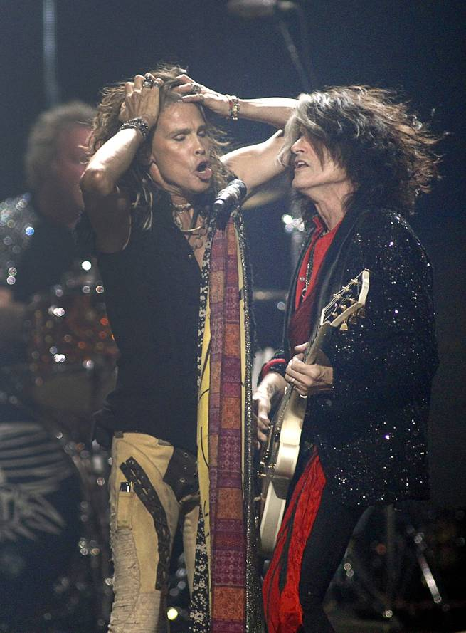 Steven Tyler and Joe Perry of Aerosmith perform during the second night of the 2012 iHeartRadio Music Festival at MGM Grand Garden Arena on Saturday, Sept. 22, 2012.