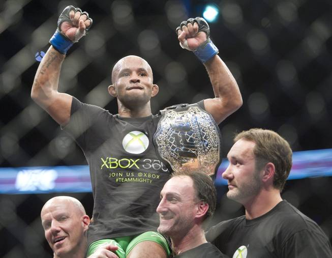 Demetrious Johnson holds the winning belt after defeating Joseph Benavidez during the flyweight championship title bout at UFC 152 in Toronto on Saturday, Sept. 22, 2012.