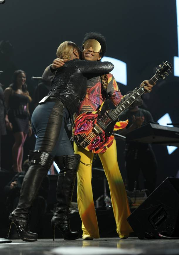 Mary J. Blige and Prince embrace during Night 2 of the 2012 iHeartRadio Music Festival at MGM Grand Garden Arena on Saturday, Sept. 22, 2012.