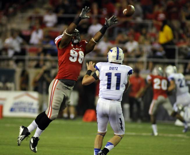 Rebel defensive end James Boyd leaps to block a pass thrown by Air Force quarterback Connor Dietz during the first quarter of the Mountain West season opener at Sam Boyd Stadium on Saturday night.
