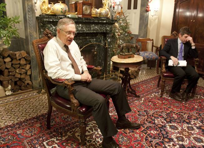 Senate Majority Leader Harry Reid, D-Nev., and David Krone, right, a member of his staff, meet in Reid's office on Capitol Hill in Washington, D.C., Monday, Dec. 21, 2009.