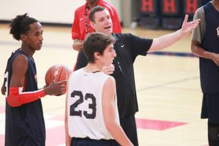 Findlay Prep basketball coach Todd Simon works with his players Wednesday, Sept. 19, 2012.