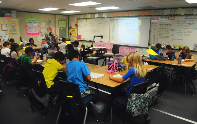 Wright Elementary School fourth-graders works on a writing assignment on Wednesday, Sept. 26, 2012.
