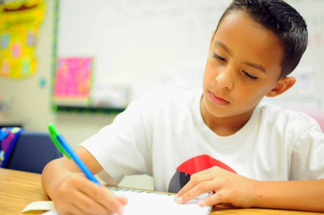Wright Elementary School fourth grader Joshua Rodriguez, 9, works on a writing assignment on Wednesday, Sept. 26, 2012. Wright has nearly 1,200 students enrolled this year.
