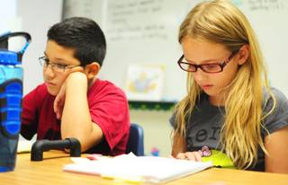 Wright Elementary School fourth graders Lillian Prince, 9, and Abraham Arias, 9, work on a writing assignment on Wednesday, Sept. 26, 2012.