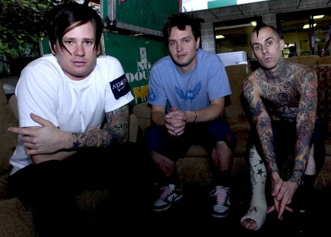 Members of Blink 182, Tom DeLonge, left, Mark Hoppus, center, and Travis Barker relax before their concert at the Tweeter Center in Mansfield, Mass., Tuesday, June 8, 2004.