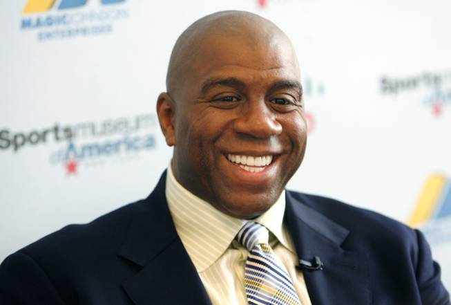 "Basketball legend turned entrepreneur Magic Johnson tours the Sports Museum of America in New York, Friday, Nov. 21, 2008. Johnson was there to promote his new book, ""32 Ways to be a Champion in Business""."
