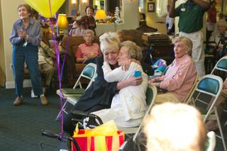 Karen Hall, at left, hugs Lucille Murn who celebrates her 102nd birthday at the Atria Seville Senior Community, Thursday Sept. 27, 2012.
