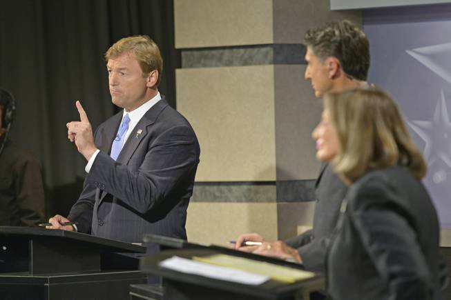 Sen. Dean Heller, R-Nev., debates his challenger, Rep. Shelley Berkley, D-Nev., at the Reno public television studios, Sept. 27, 2012 as Mitch Fox, center, moderates.
