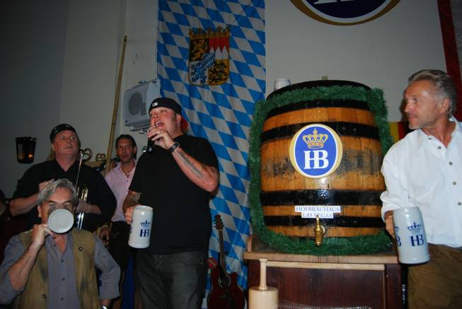Corey Harrison taps the keg at Hofbrauhaus for Oktoberfest on ...