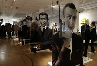 A general view of the James Bond movie memorabilia charity auction at Christie's auction house during the press pre-view showing large portraits of the actors who have portrayed the famous movie icon James Bond, with Sean Connery, at right,  in London, Friday, Sept. 28, 2012.