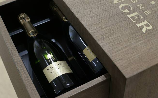 A limited edition 50th anniversary cabinet containing twelve vintages of Bollinger R.D. Champagne is seen at the James Bond movie memorabilia charity auction at Christie's auction house in London, Friday, Sept. 28, 2012. Bollinger was first asked for in a Bond movie by Roger More in 'Live and Let Die' in 1974, and has been used several times since .The champagne is expected to raise some 10-15,000 British pounds ($16,-23,000, euro 12-17,000) with the proceeds going to UNICEF.