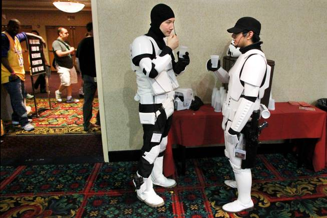 Dressed as storm troopers from Star Wars, Emmanuel Chen, left, and Perry Caddauan take a water break at the Las Vegas Comic Expo Saturday, Sept. 29, 2012.