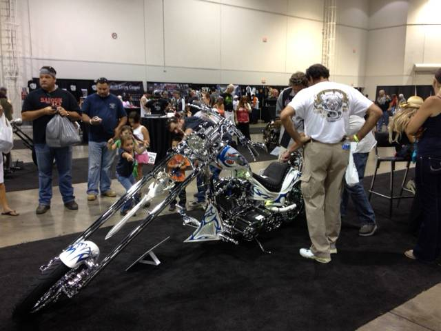 People take a closer look at Vaughn Spurlock's entry at the Artistry in Iron competition at Las Vegas Bike Fest on Saturday, Sept. 29, 2012.