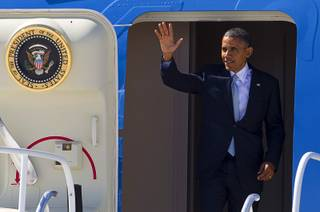 President Barack Obama waves as he arrives at McCarran International Airport Sunday, Sept. 30, 2012. Obama will attend a campaign rally then stay in Henderson as he prepares for his first debate with Republican presidential candidate Mitt Romney. The debate will be held in Colorado Wednesday.